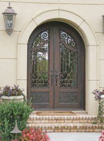 Custom round Top Iron Door with a French Curved middle rail