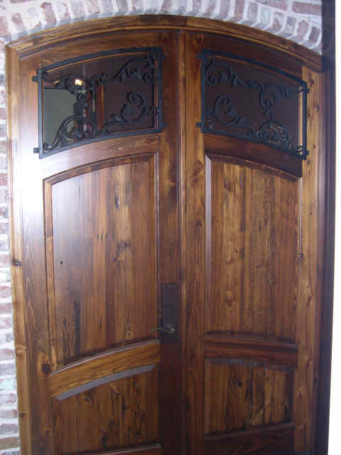 Arched top antique doors with iron