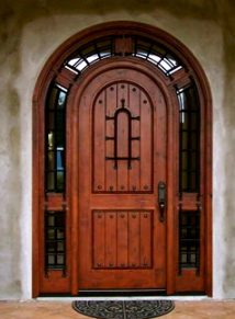 Round Top Plank door with wrap around transom and iron