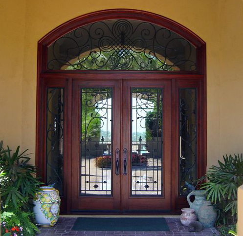 Gorgeous iron and wood with transom and sidelites