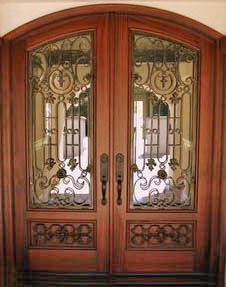 IRON AND WOOD ARCH TOP DOOR