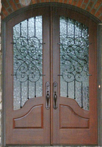 ARCH TOP WOOD AND IRON DOOR WITH FRENCH PANELS