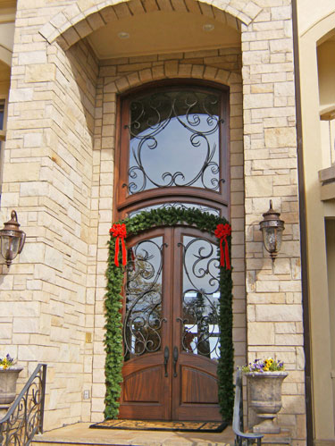 MAHOGANY ARCH TOP DOOR AND TRANSOM WITH IRON