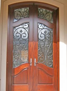 FRENCH CURVE PANELS ON THIS MAHOGANY WITH IRON DOOR